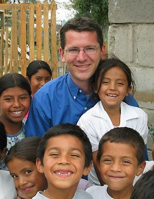 Scott with sponsored children in Honduras