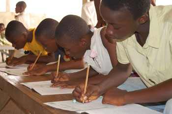Children copying letters from their exercise books