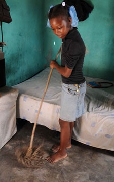 boy mopping floor