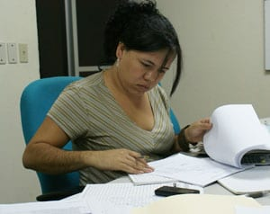 woman reviewing reports