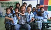 Pastor Romy Villarta is very comfortable and natural with the sponsored children.