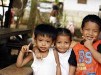 three smiling children
