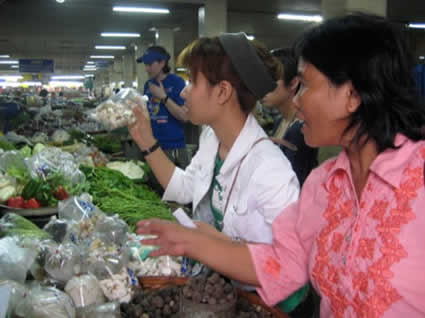 two women selling wares at a market
