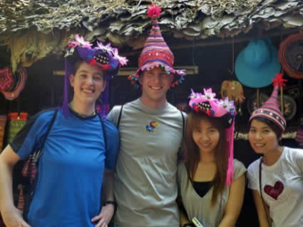 man and woman and two girls wearing colorful hats