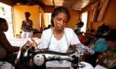 Ghanian woman sewing in her shop.