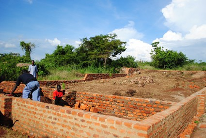 men laying bricks for a house