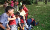 Boys playing San Pirutejo in Ecuador
