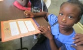 girl-in-haiti-with-letter