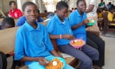 Teens in Ghana enjoying lunch