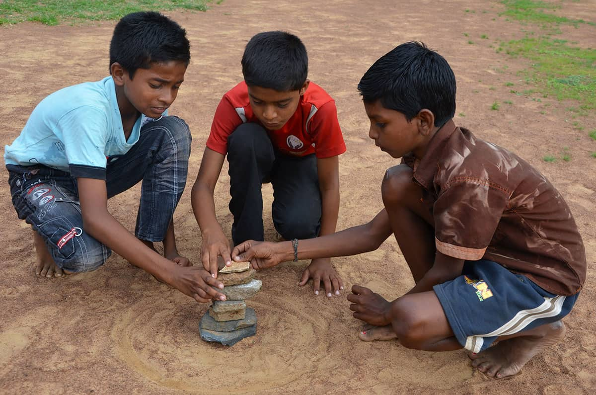 Traditional Game in India: Seven Stones Stacking