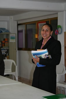 smiling woman standing holding books