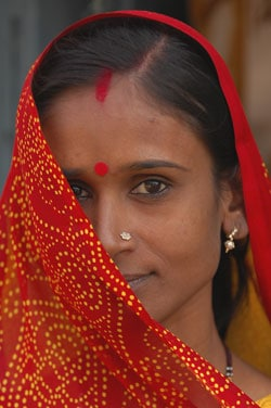 ending poverty indian woman in red