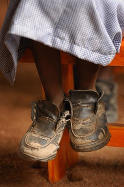 ending poverty old shoes