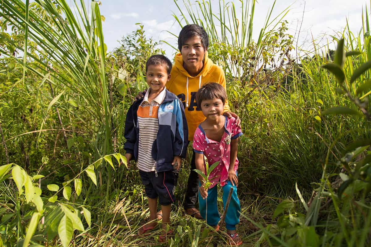 Natapong, who is enrolled at the CDC, and his family show off a healthy tea plant still too young to start picking. These plants should be ready for their first harvest late 2016.