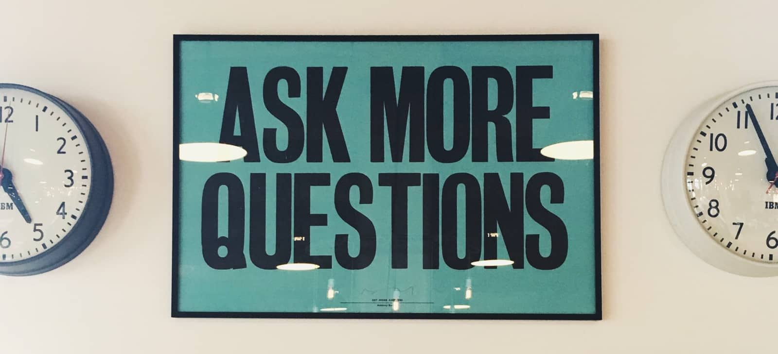 ask more questions poster with clock on each side