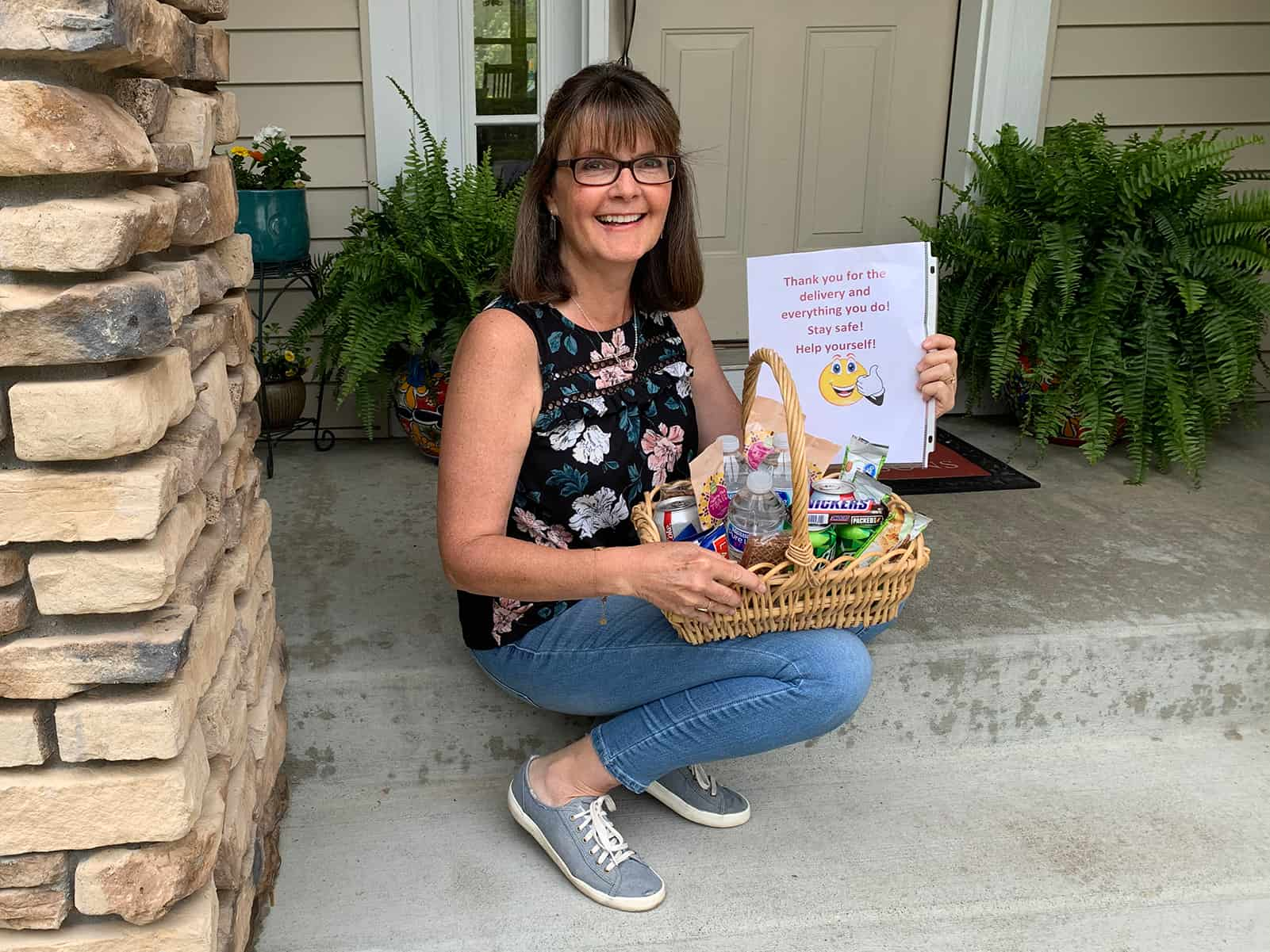Lisa poses with one of her care baskets