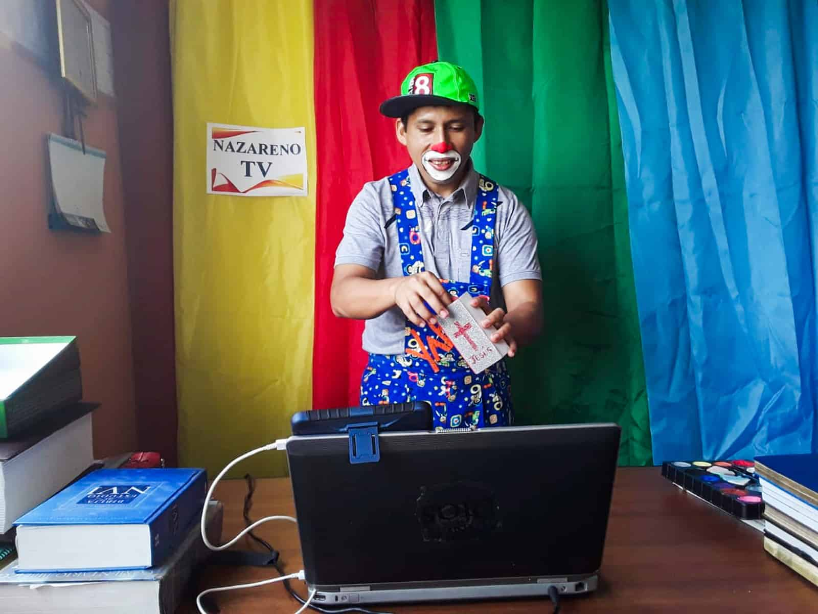 Man dressed as a clown performing for a livestream